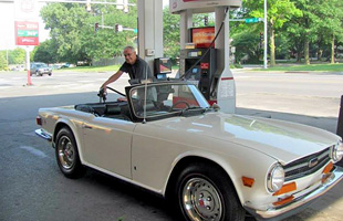 Man filling up gas in gas station