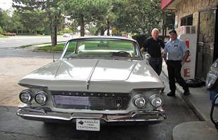 Two men beside a car