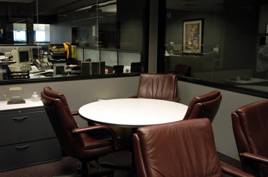 Office Room With A Round Table And Drawer Boxes ...