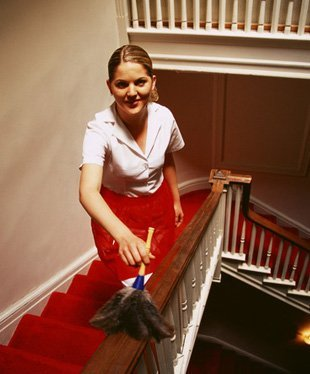 Maid cleaning the staircase