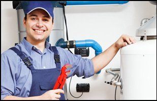 Smiling repairman with wrench on his hands