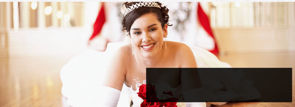 Photograph of the bride holding a red bouquet