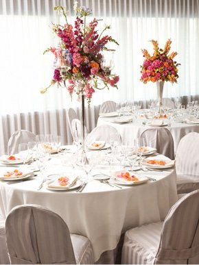 A white motif table setting with flowers on the top
