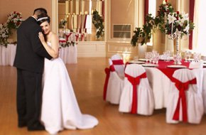 A dancing newly wed couple