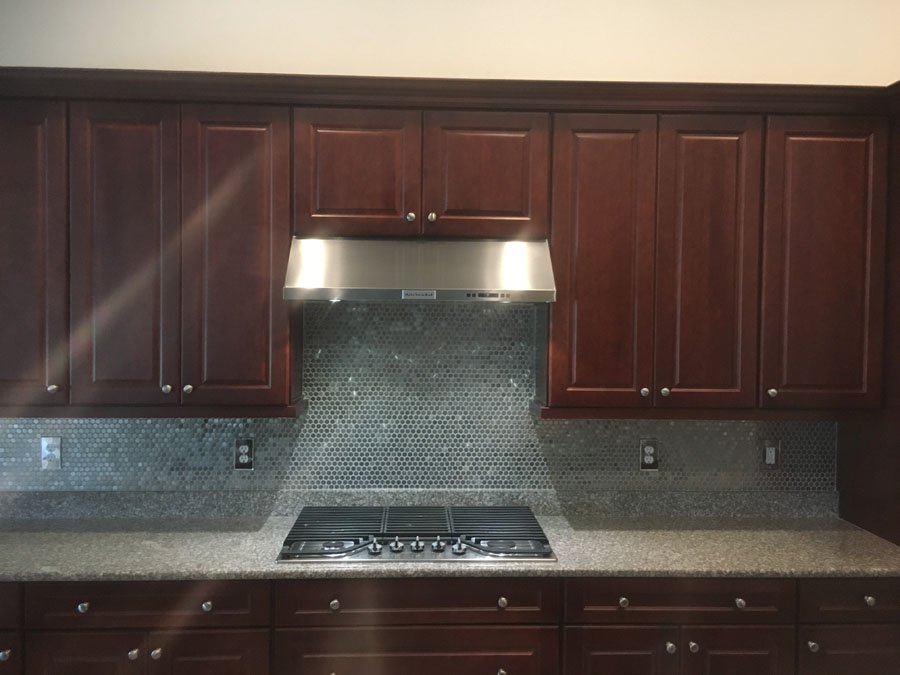get an easy to clean tiled backsplash installed in your