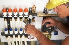 Plumber repairing pipe