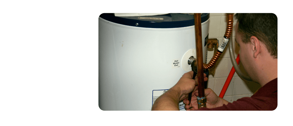 Plumber working on water heater