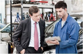 Auto repairman showing his observations about the problem of the customer's car