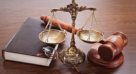Legal book, justice scale and gavel
