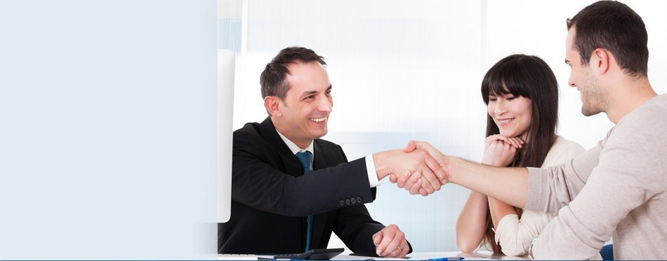 Attorney shaking hands with couple