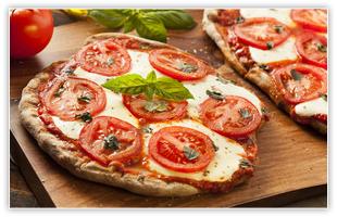 Organic homemade margarita pizza with basil and mozarella
