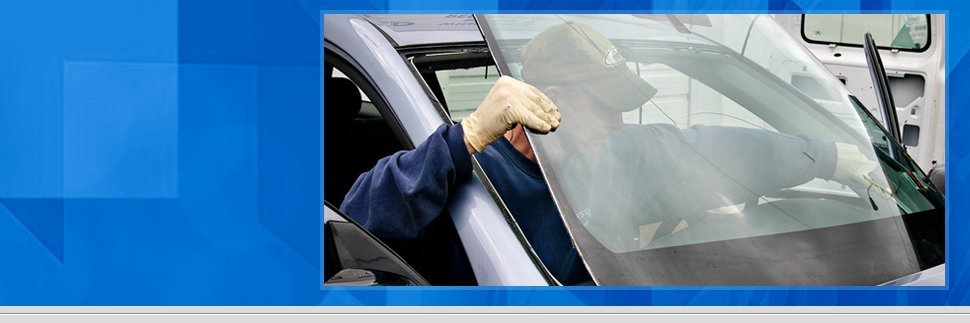 Man installing windshield