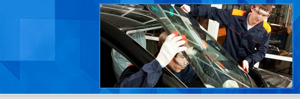 Auto mechanic repairing auto windshield