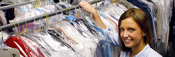 Woman with dry cleaned clothes