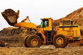 Bulldozer clearing lot