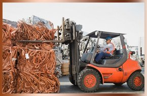 Man operating a truck and recycling copper