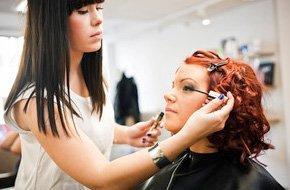Makeup artist applying makeup  to a customer