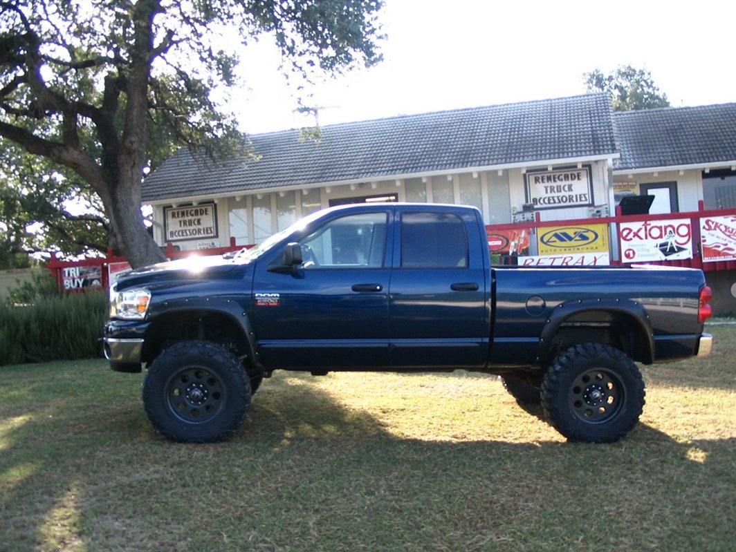 Blue truck with lift kit