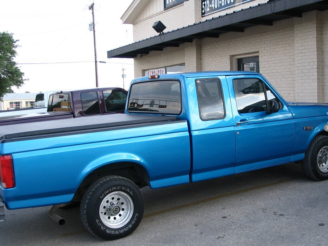 Blue truck with tonneau cover