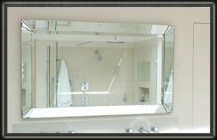 A customed mirror in a luxurious bathroom.