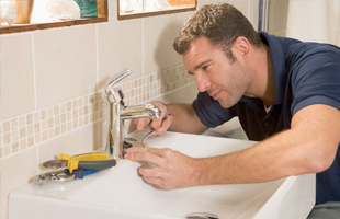 Plumber serviceing