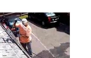 Employee cleaning gutter