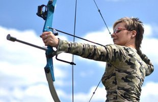 Woman practicing archery