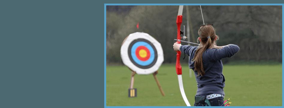 Woman learning archery
