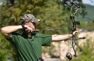 Man practicing archery
