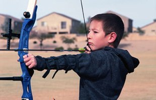 Boy learning archery
