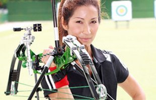 Woman practicing archery