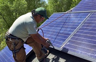 Man checking on solar roof