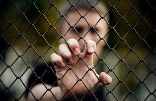Guy behind bars