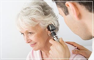 Old woman have check up of her ear