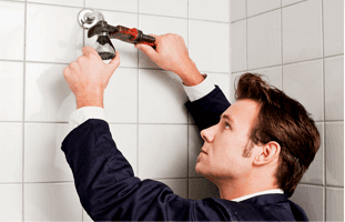 Plumber fixing a shower