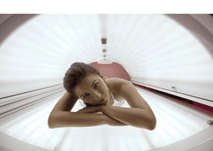 Beautiful woman tanning