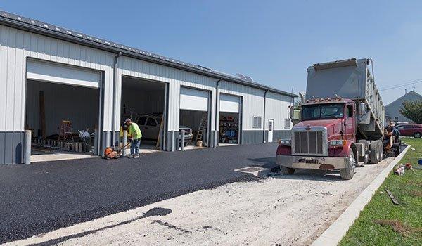 Men working on asphalt