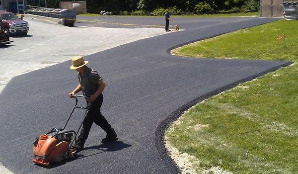 Man working on asphalt