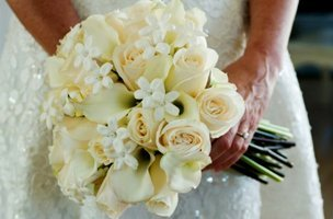 A bride holding her white bridal flower