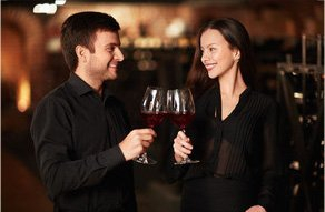 Young couple in wine cellar