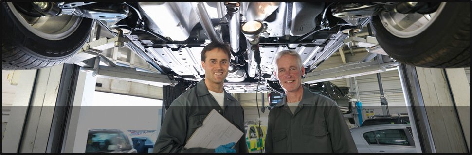 Two mechanic smiling