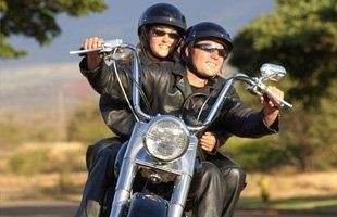 Couple riding a big bike
