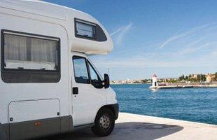 Travel van parked on sea side