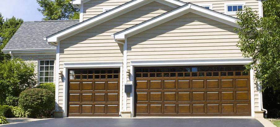 Beige House With Wood Garage Doors