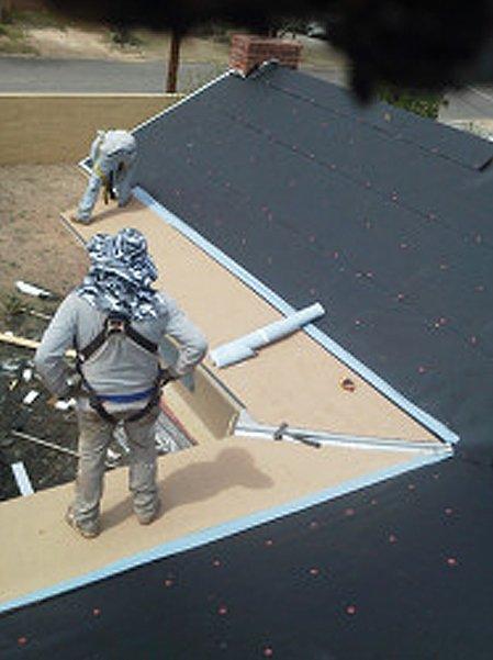 Two men installing roof