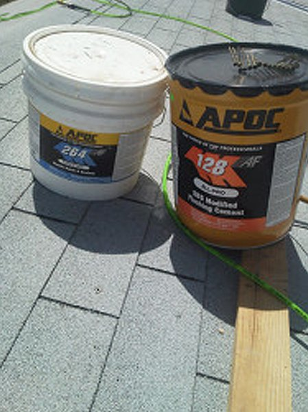 Two APOC plastic roof cement