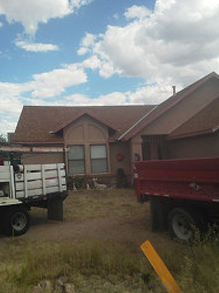 Two trucks outside the house