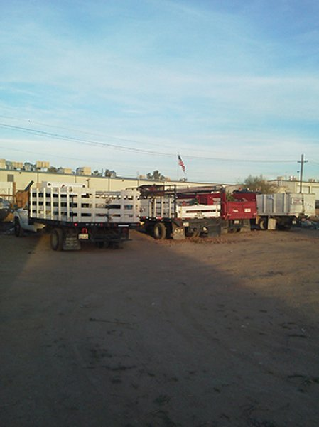 Four trucks parked in a lot