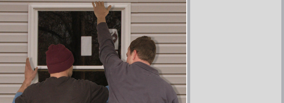 Man Installing Window To A Home