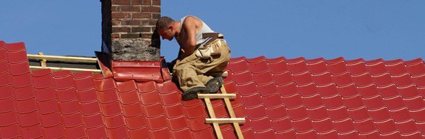 a worker installs roof